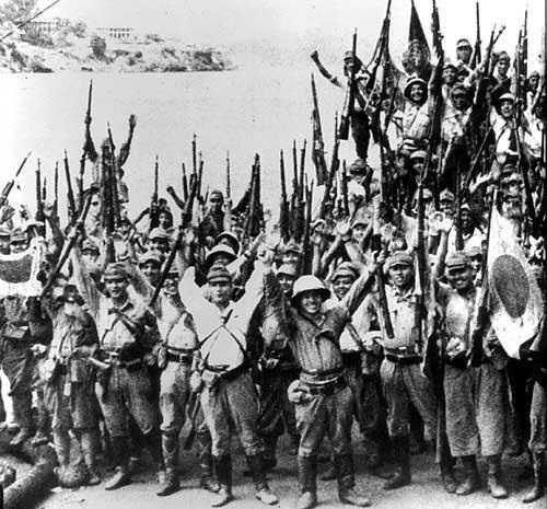 As Japanese conquerors celebrate their victory with a march through Singapore, their murderous mass purge of the Chinese population has begun.