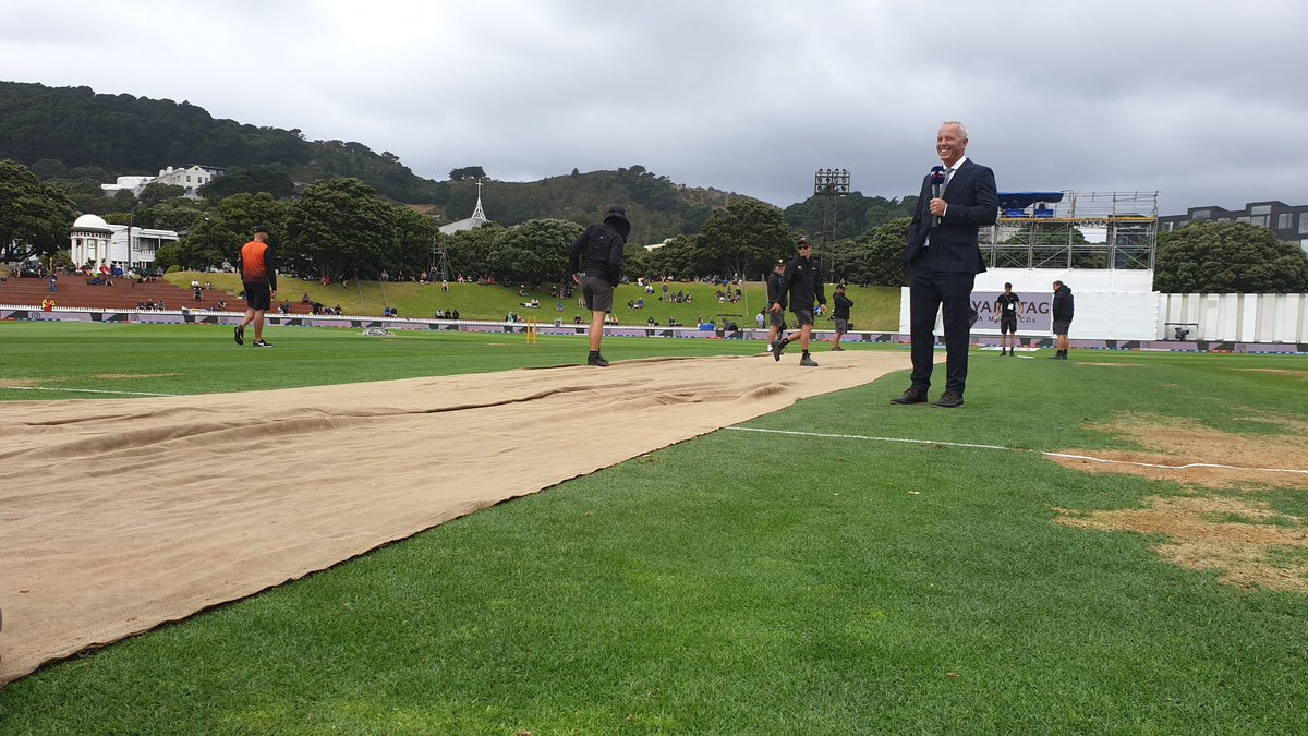 A heavy drizzle and the pitch is finally under covers. #NzvIND