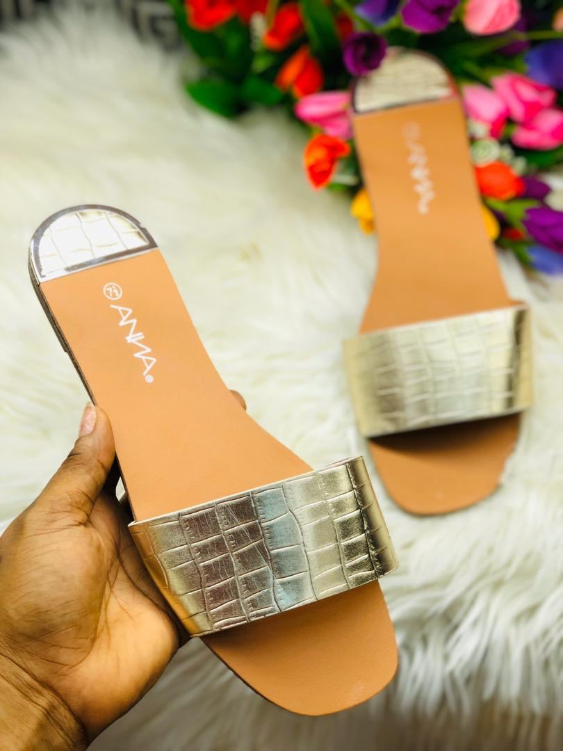 *croc skin leather slides*.      Colors: Gold , White , Black.          Price : N7,000.                              Size : 37-41 Contact us by sending direct message or WhatsApp 08023194495 Nationwide delivery with fees <br>http://pic.twitter.com/syXuTvyjnc