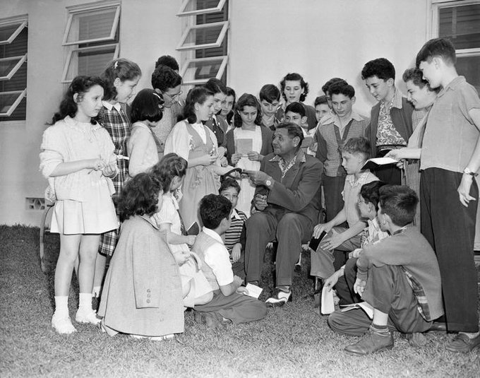 Babe Ruth signs autographs at Mending Heart Cardiac Home in Miami, Florida on this date February 21 in 1948. Photo by AP. #BaseballGuterman #OTD