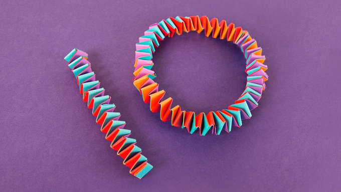 The number 10, written using colorful criss-crossing strips of folded paper.