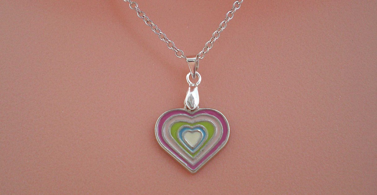 A dainty enamel heart pendant on a sterling silver chain. #heartpendant #heartnecklace #pinkpendant #pinknecklace #etsyjewelry #etsyjewelry #etsymaker #etsyfinds