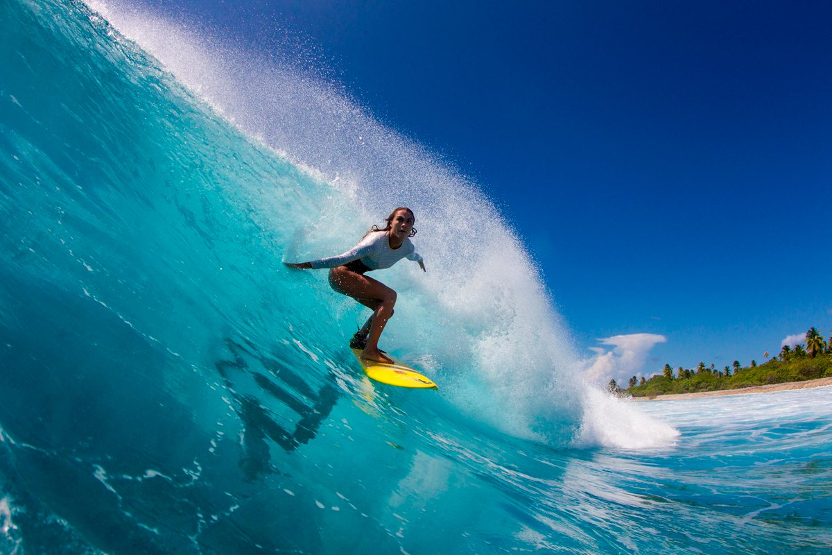 Where the waves are fast and life goes slow: Léa Brassy high lines a remote Polynesian right. Photo: Laurent Masurel
