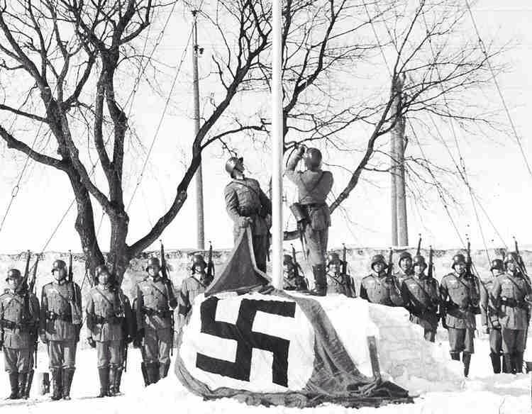 """Nazis have invaded Winnipeg, Canada- student volunteers dressed as German soldiers have captured the city, now renamed """"Himmlerstadt"""", in a stunt to raise money for war effort:"""