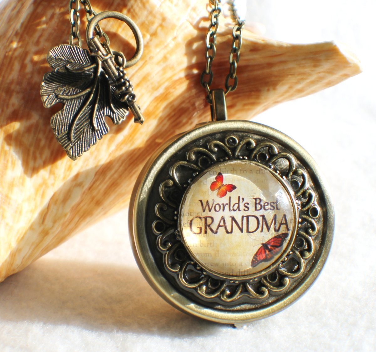 """Music box locket,  round locket with music box inside, in silver tone or bronze with """"World's Best Grandma"""" on cover.  #Handmadejewelry #Charsfavoritethings ##pottiteam #Etsy #RoundLocket"""