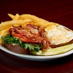 Brooks BLT, anyone? Oh my! It starts with grilled thick sliced wheat berry bread topped with white American cheese, mayo, crisp bacon, lettuce, tomato & two over-easy eggs. So good! 😁