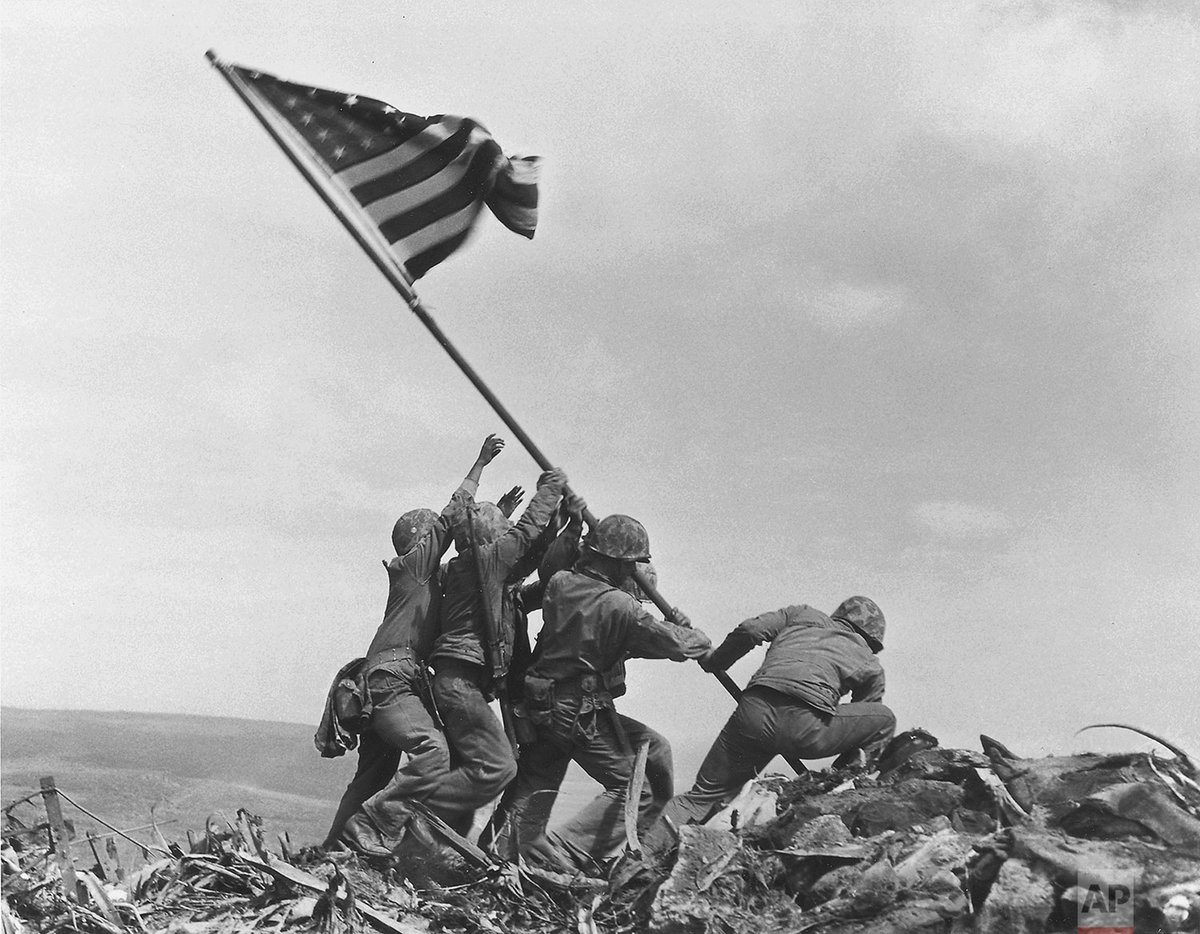 75 years today, AP photographer Joe Rosenthal captured what may be the most famous photograph of World War II: an image of six U.S. Marines raising the American flag atop Mount Suribachi on the Pacific island of Iwo Jima.