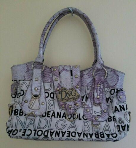 ENDING IN 4 HOURS!  Gently Used Dolce & Gabbana Leather and Fabric Tan Black Purple Purse #DolceandGabbana #ebaydeals  https://www.ebay.com/itm/324075280391…pic.twitter.com/I19HP6kpZa