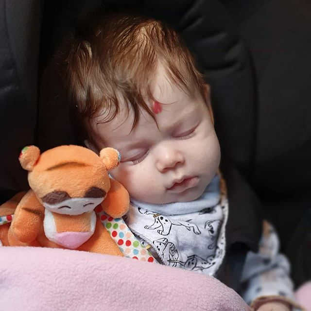 Sleepy baby in car today. Oliana cuddling Tigger ♥️ #baby #tigger #disney #sleep #dalmation #101dalmatians #cute #strawberry #birthmark #hair #somuchlove #cosy