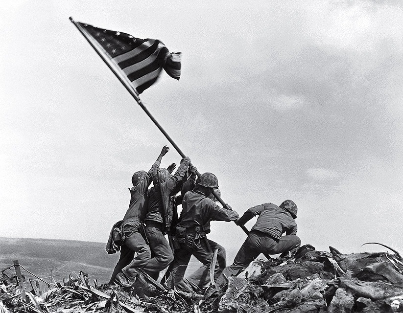 @usmarines raised #Americanflag  over #IwoJima  75 years ago today. The six men in the photograph were identified as Harlon Block, Harold Keller, Ira Hayes, Harold Schultz, Franklin Sousley and Michael Strank the photo was taken by @AssociatedPress photographer Joe Rosenthalpic.twitter.com/OxoidmuLzk