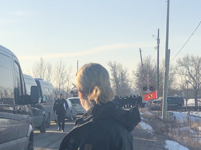 From CBC's Olivia Stefanovich at Wet'suwet'en solidarity camp set up by the Mohawks of Tyendinaga: 'Very tense scene. Dozens of police officers moving in the camp. They are blocking reporters from getting any closer than this.'