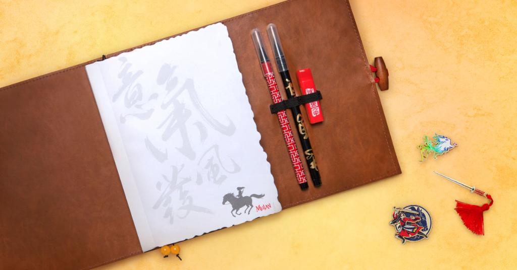 Pins and a journal from the new Mulan movie.