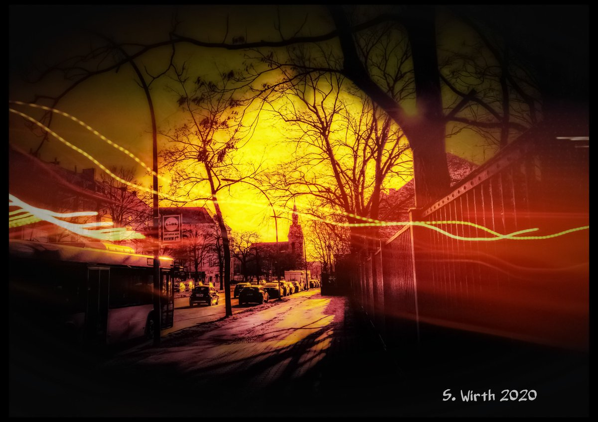 #street and #motion with adjacent #church in district #Spandau as urban #scenery with #yellow #sky and #leafless #trees on a #winter #day  in #Berlin as #artphotography #February #2020  Copyrights #Stefan #F. #Wirth  #lights #urban #wideangle #photography #streetphotography