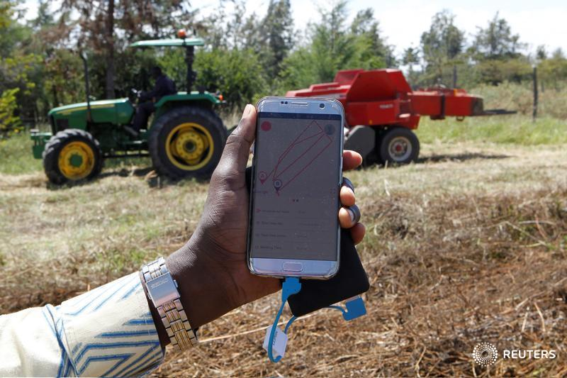 """It's ride-hailing, farm style. Deere & Co. is teaming up with the """"Uber of tractors"""" in Africa and betting on a future where farmers summon machines with the touch of a button. Reporting by @shurufu  and @JoeBavier   https://af.reuters.com/article/topNews/idAFKCN20J0V7-OZATP…pic.twitter.com/n6jqQPdtbL"""
