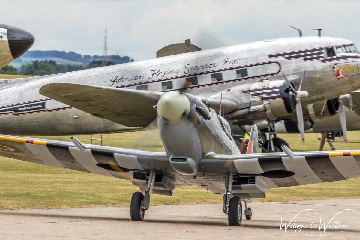 Supermarine Spitfire Mk. IXb MH434 taxying out with C47 'Miss Montana' (N24320) in the background at Daks Over Duxford @ww2spitfire @SocietySpitfire @IWMDuxford @BofB1940 @DuxfordAirshows @LoveWW2Planes @AirshowsOfTheUk #Airshows #dday75 #daksovernormandy #Spitfire https://t.co/nUuTnB0ZtA