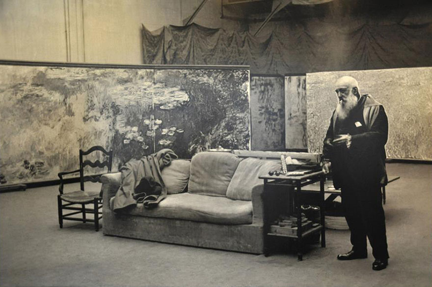 Claude Monet in his studio. Note the size of his water-lily paintings.