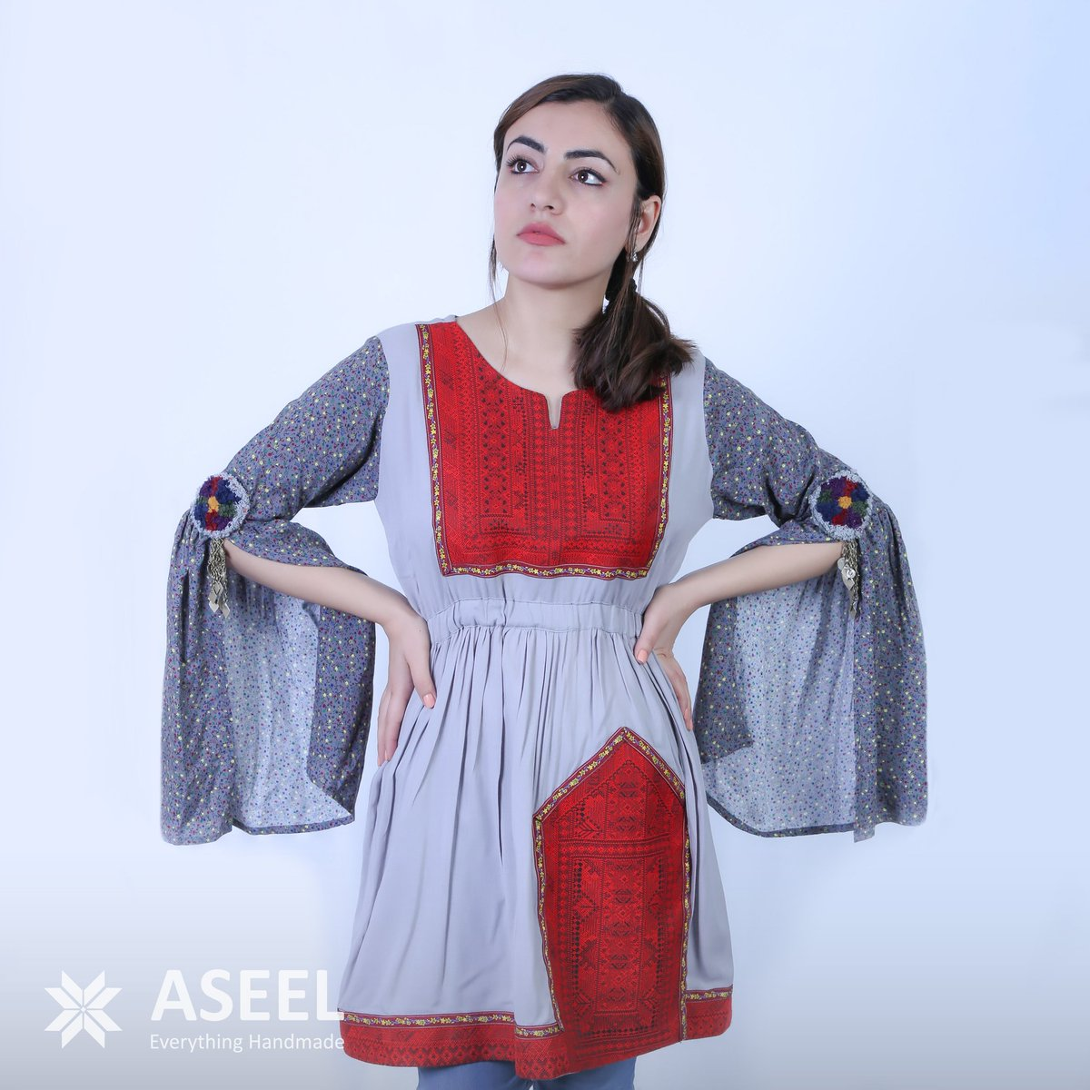 No fifty shades of grey here! Check out this grey and scarlet tunic from Jama Design. Flowing sleeves and embroidered details give it the perfect amount of unique flair. This and more from Jama on #ASEEL.  #dress #dresses #instatags #clothes #fashion #style #amazingdress <br>http://pic.twitter.com/9tjagYeDsK