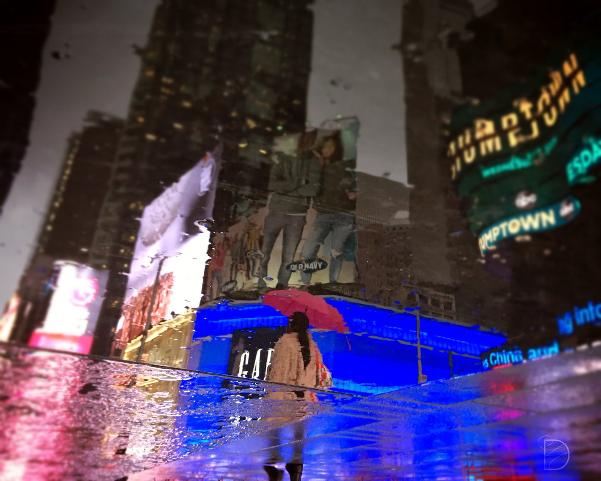 """""""Mind the gap!""""  or  """"Find your light!"""" . . . #timessquare #nyc #rainyday #rainynight #lightsarebrightonbroadway #onbroadway #broadway #umbrella #thinkpink #pink #reflection #upsidedown #iloveny #manhattan #photooftheday #picoftheday #iphoneonly #shotoniphone #mobilephotography"""