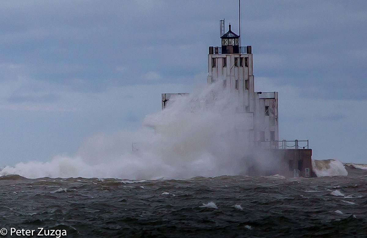 The Main Gap #lighthouse engulfed in a #wave on #LakeMichigan #GreatLakes in #Milwaukee #Wisconsin this afternoon. #storm #weather #winter #mytown #photojournalism #landscapephotography #photography