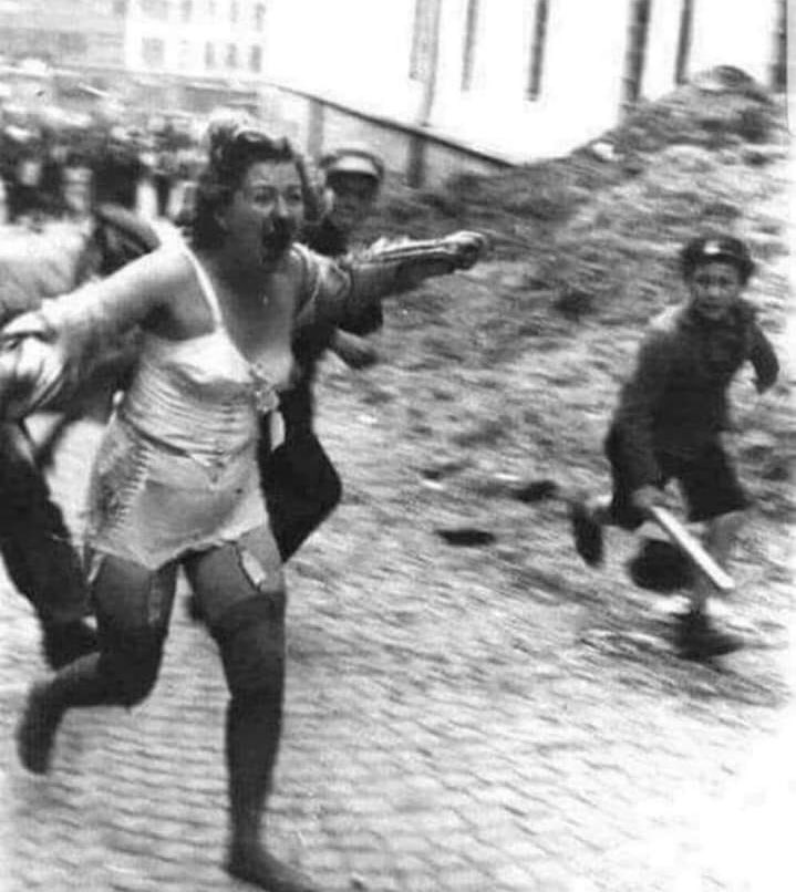 Fascism is a mental illness that can even transform children into monsters. Picture from the Lviv pogrom in 1941. A Jewish woman chased by men and a child armed with clubs .