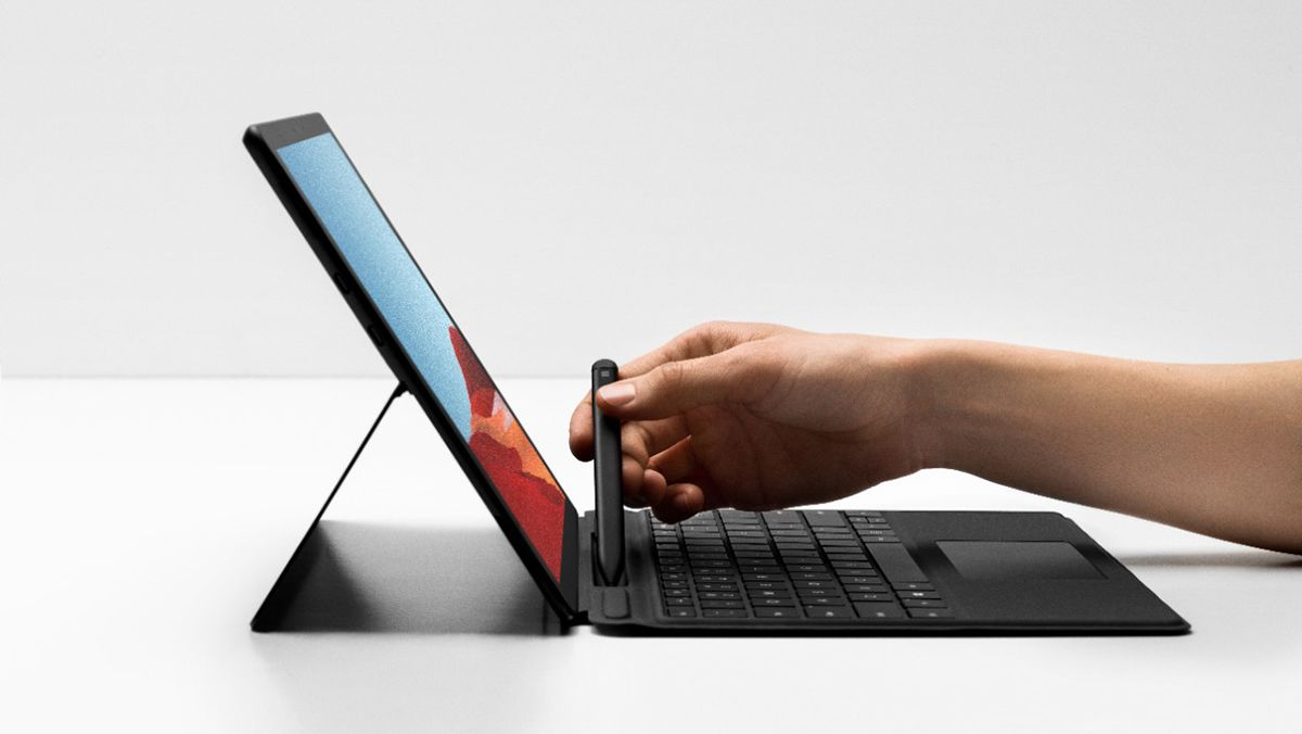 The Surface Pro X with Type cover and Slim Pen, set against a bright white background.