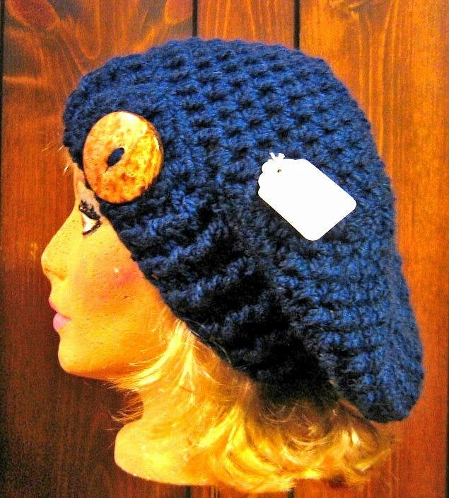 Excited to share the latest addition to my #etsy shop: Slouchy Beanie Hat with Coconut Button Tab,  #accessories #hat #blue #slouchyhat #navyblue #womensaccessories #coconutbutton #handmadecrochet #madeincanada