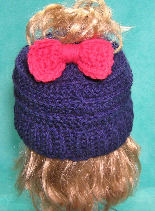 Excited to share the latest addition to my #etsy shop: Messy Bun Hat with Hot Pink Bow  #accessories #hat #blue #pink #crochetponytailhat #wintergear #ponytailbeanie #fashionaccessories #momlifehat