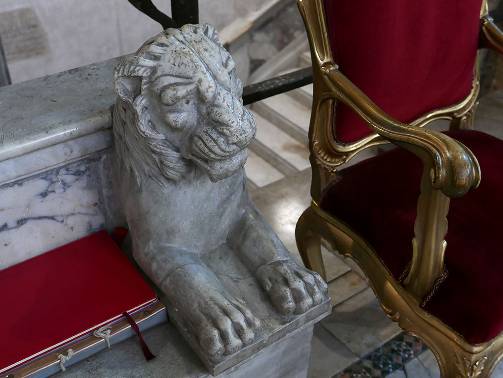 A very attentive lion just tries to blend in at S Lorenzo fuori le mura, #Rome #AnimalsOnFurniture #AnimalsInChurchesHour #MedievalArt
