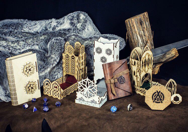 Some of our #Kickstarter backer rewards! Fuck #D20, Elven dice tower, Dwarven dice tower, leather journal, metal dice set, mechanical locking #dice box, exclusive event drive towers, inspiration coaster, limited edition ring  #DnD #dungeonsanddragons #rewardspic.twitter.com/KOcIeTC1NK