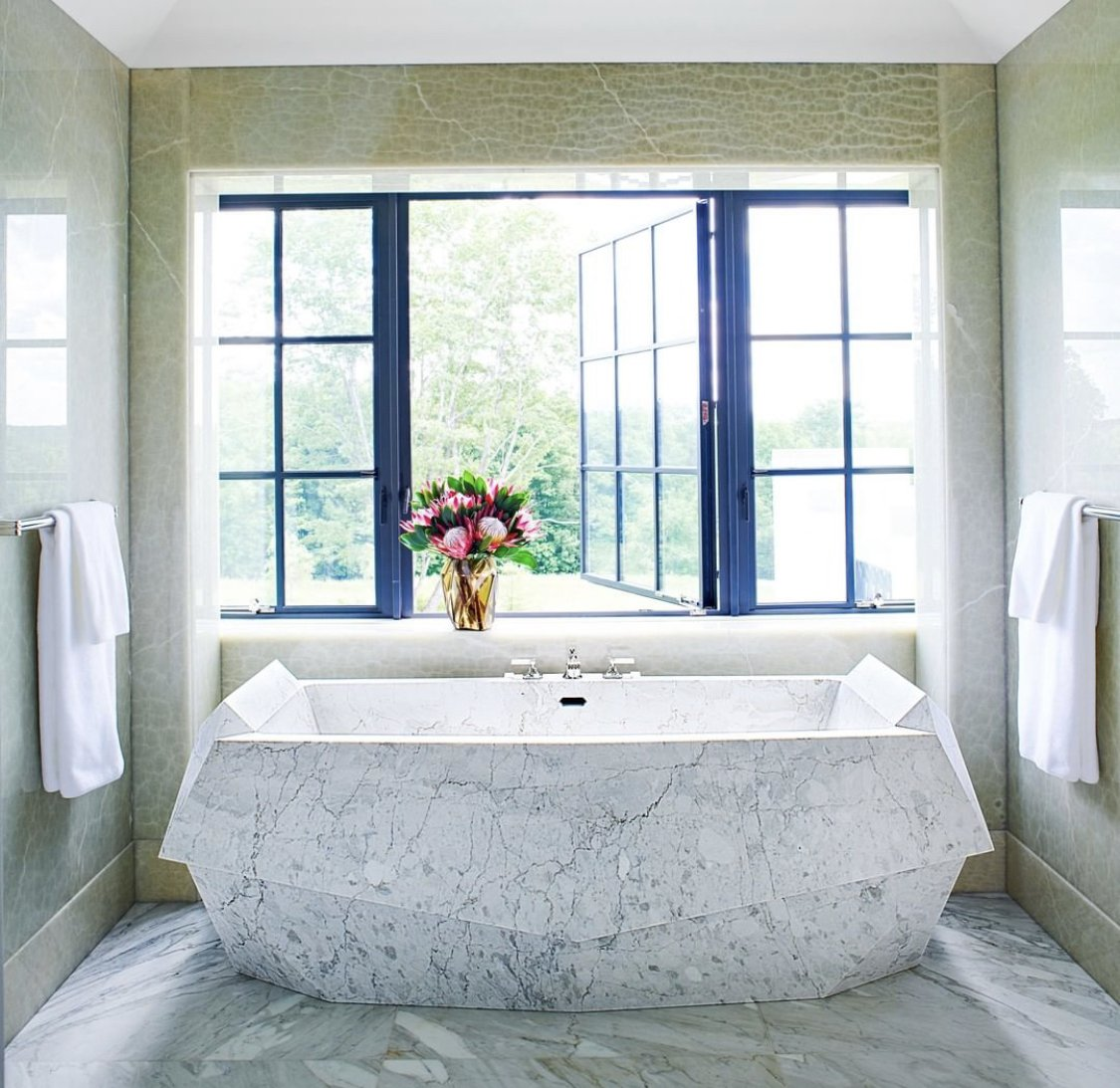 Custom-made bathtub carved from a single piece of Calacatta marble 😍  #LA #hiltonhyland #luxuryhomes #milliondollarlisting #residential #realestateagent #zillow #luxuryrealestate #architecture #views #l4l #followback #instafollow #teamfollowback #picoftheday #iamyouragent