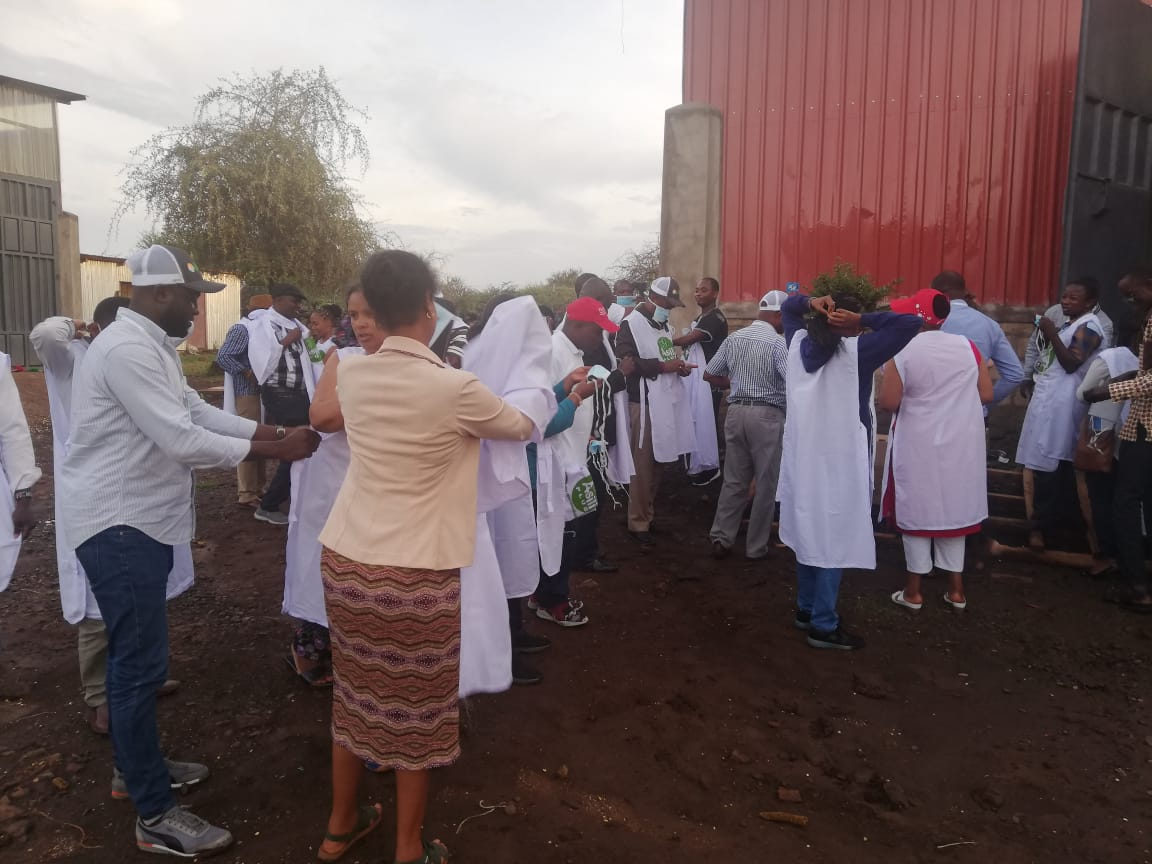 IFDC/2SCALE  international training Inclusive Agribusiness: Linking farmers to Markets #Day3, Field visit to the flour milling factory. Participants putting on appropriate gear to enter  the factory.
