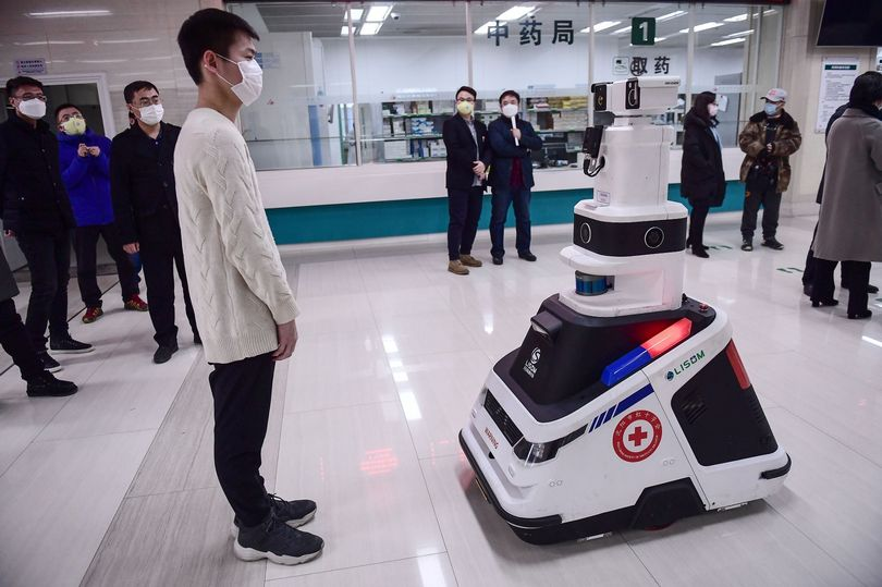 Coronavirus robots are patrolling hospitals to help curb the spread of the virus