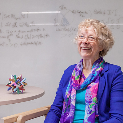 """""""Mathematics helps me to understand the world, and I am really passionate about the mathematics of symmetry. I study its theory, and use this to produce computer algorithms to analyse symmetry groups."""" - Cheryl Praeger #IWD #IWD2020 <br>http://pic.twitter.com/imn4kz8iP4"""