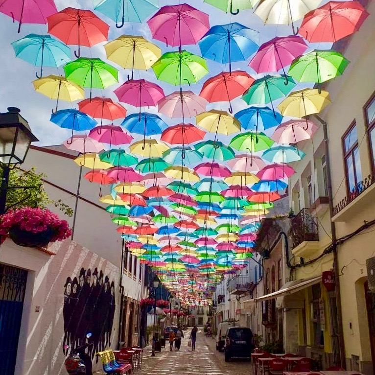 The amazing Umbrella Sky Project in Agueda. A really beautiful and colourful way to start your day #umbrellasky #umbrella #aveiro #agueda #portugal #travel #ThursdayMotivation @visitportugal @365Disc_Portpic.twitter.com/njvASmy8xn