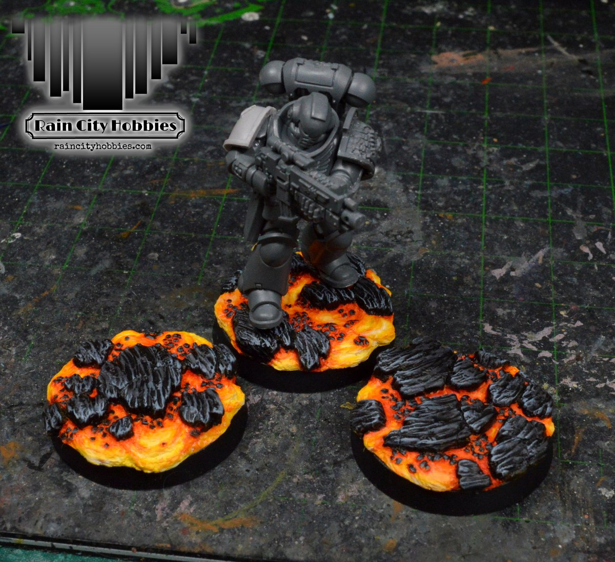 Here are some more lava bases I've been working on! They're coming along nicely, you can find them here: https://t.co/2voXtufzDN  #minipainting #miniatures #warmongers  #miniaturepainting #Warhammer #40k #warhammer40k #wh40k #ageofsigmar #aos https://t.co/nMI2eGM3Gy