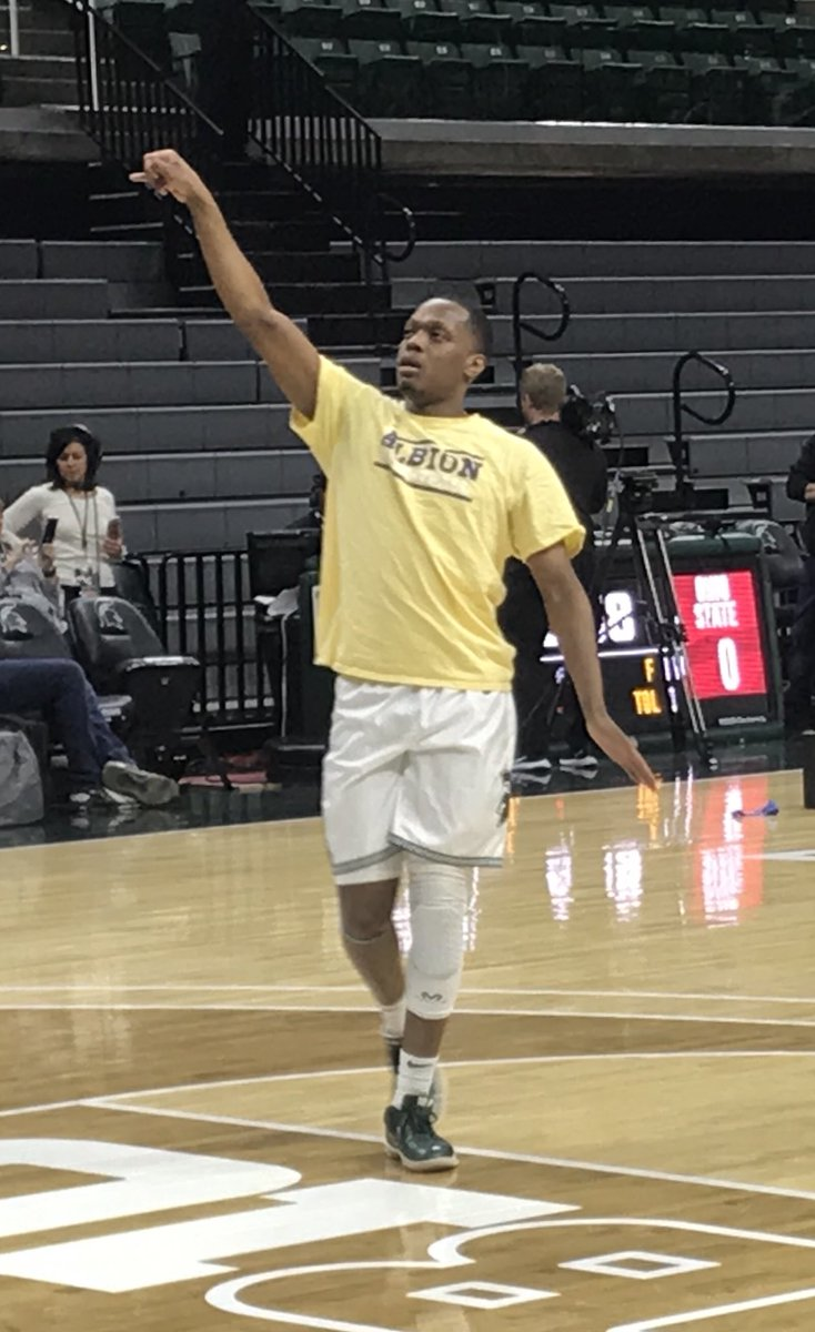 Cassius Winston in an Albion shirt as he warms up for his final game at the Breslin Center