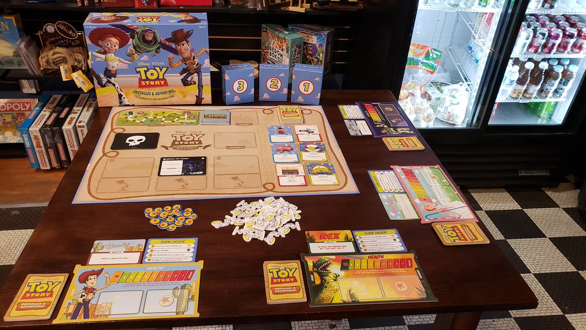 Andy's gone! Time to play! Join me @RedRaccoonGames in Bloomington until 5pm for a demo of @TheOpGames newest co-op deck builder, Toy Story Obstacles and Adventures. Can you and the other toys overcome hazards to complete the mission? Come check it out! @DexEnvoy https://t.co/MfKfHSs9RG