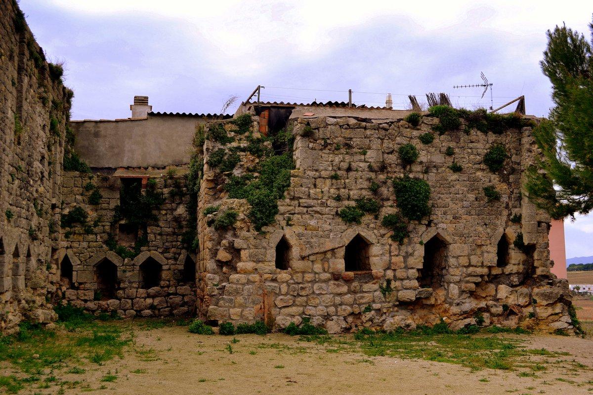 <a href='https://en.wikipedia.org/wiki/Bee_bole'>Bee boles</a> for skeps in the castle wall at La Granada, Barcelona, Spain. Wikipedia in Catalan still thinks they're loopholes. / Nínxols per a <a href='https://ca.wikipedia.org/wiki/Rusc'>ruscs</a> en la muralla del castell de La Granada, Barcelona, Espanya. La Viquipèdia en català creu encara que són espitlleres.