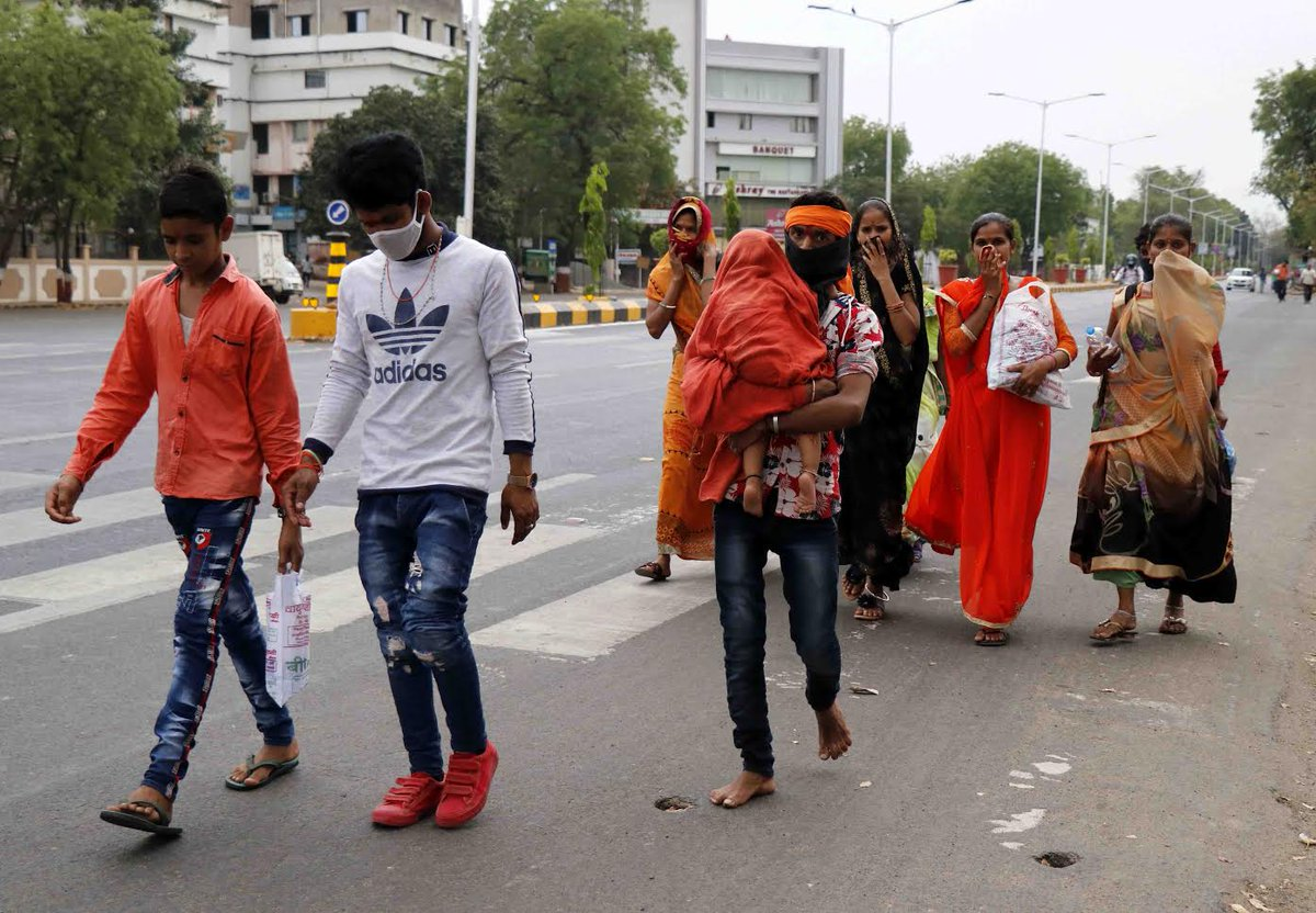 Police, voluntary organizations, Nitin Patel comes to rescue of hundreds of migrant workers walking to Rajasthan