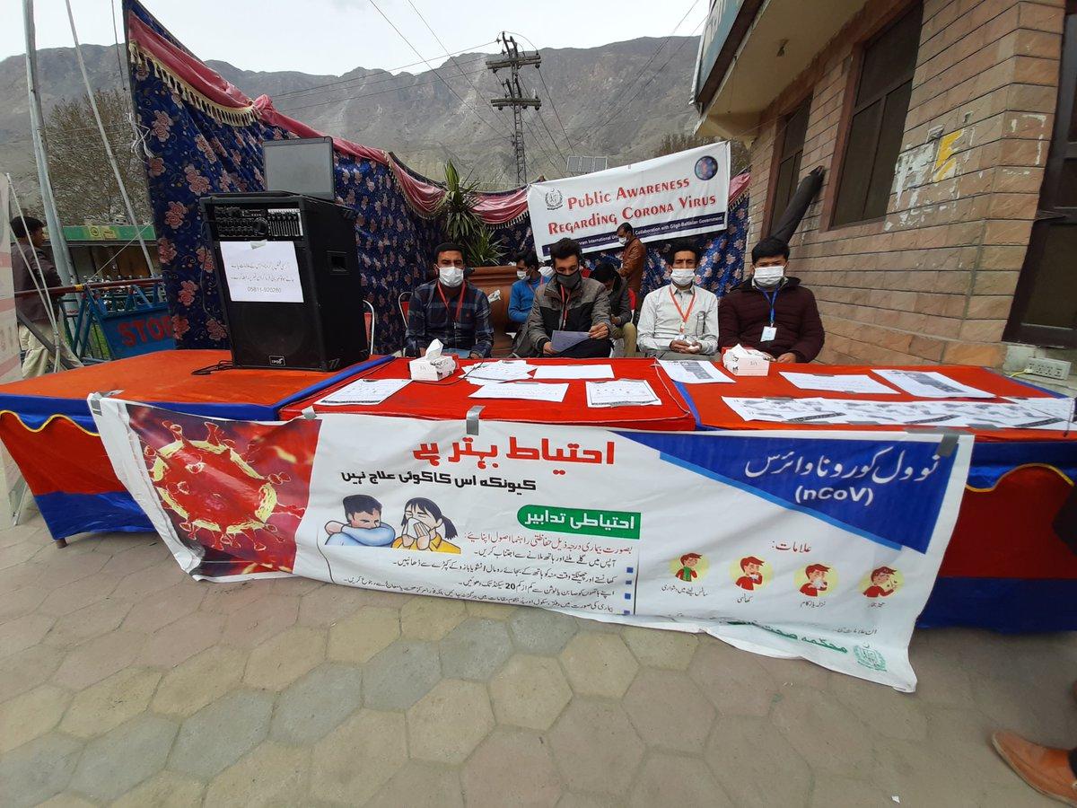 Students of #Karakoram Int'l University held an awareness camp in #Gilgit city to inform citizens about precautionary measures to combat the #coronavirus pandemic .