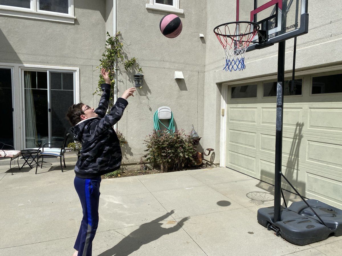 Having family contests jumping rope and shooting hoops in our driveway to get fresh air and exercise.