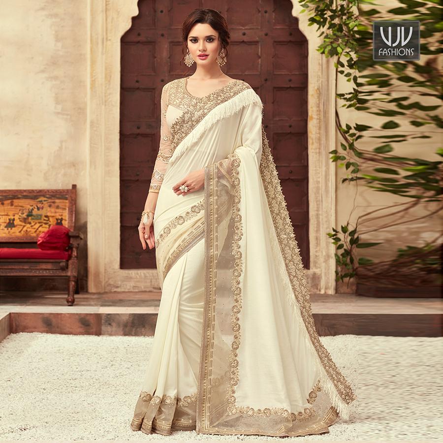 Buy Now @ http://bit.ly/2U5zlE2  . Glossy White Color Embroidered Silk Designer Saree . Fabric - Art Silk . Product No  VJV-TFH22009 . #saree #sarees #designersaree #weddingsaree #bridalsaree #silksaree #banarasisarees #netsaree #ethnicsaree #partywearsaree pic.twitter.com/qFUA58vjCg