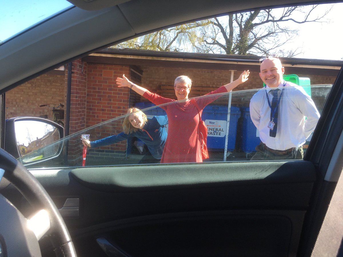 Another weird school meeting through my car window with my social distanced colleagues.