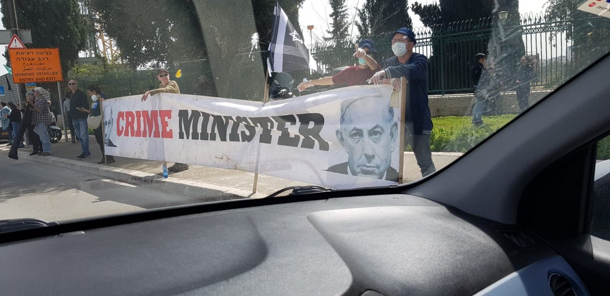 'I'd rather die of #corona than die in a dictatorship' in front of Knesset right now.