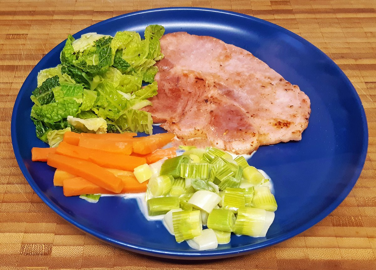 Gammon with savoy cabbage, Carrot batons and creamed leeks.