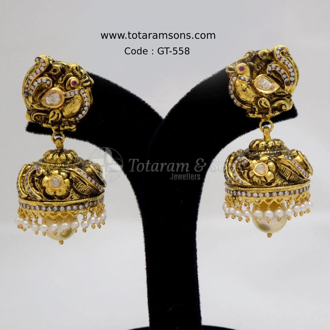 Let the grandeur of this Beautiful Deep Nakshi #Uncut #Diamond Peacock Bridal #Jhoomki with exquisite handcrafted workmanship. Code : GT-558,  Buy Now @ https://bit.ly/2vMCq3Q  #Goldjewellery #DiamondJewellery #PolkiJewellery #Hyderabadjewellery #Jewelry #southindianjewellery pic.twitter.com/riFg3oMvc1