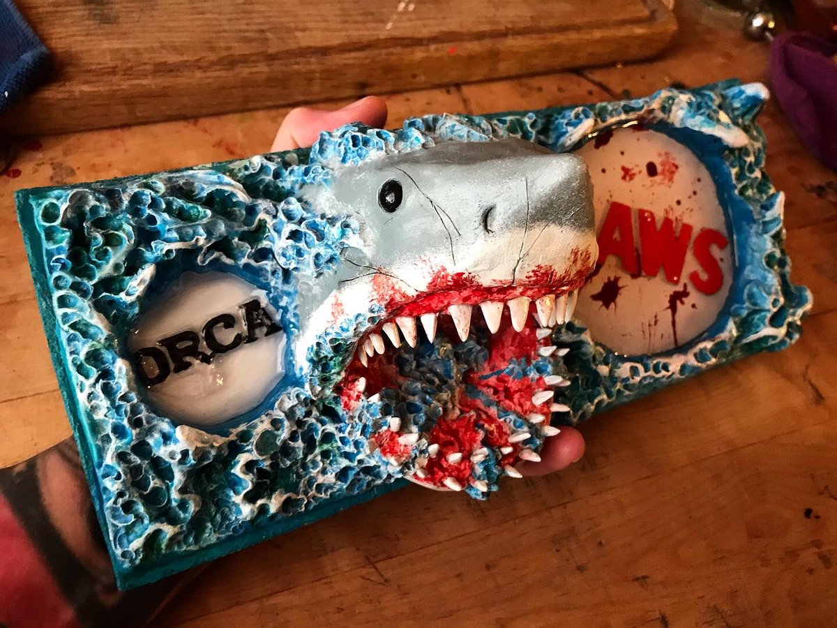 Done! Take care, y'all!   Jaws shot tray with room for a bottle and glass and a bottle opener in the oxygen tank. #jaws #horrorart #diy #wip #fanart #sculpture #supersculpey #greatwhite #greatwhiteshark #shark #smileyousonofa #breakfastofchampionspic.twitter.com/oL5nw77EbR