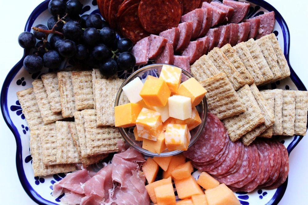 I do not OWN this pic , but my favorite snack plate  involves Cheese, #Triscuits, Hard  Salami, and grapes.