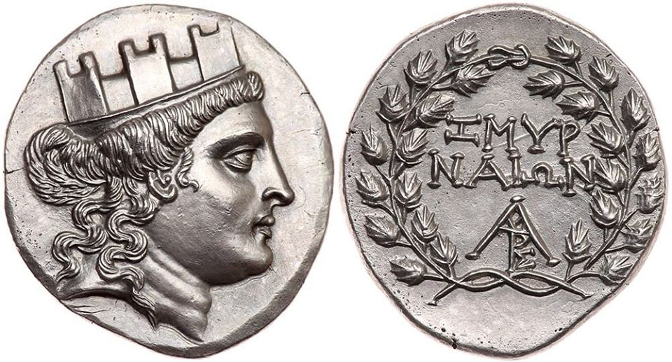 Silver tetradrachm from Smyrna,Ionia.150-143 BC.Turreted head of Tyche right.Reverse ΣΜΥΡΝΑΙΩΝ in two lines.