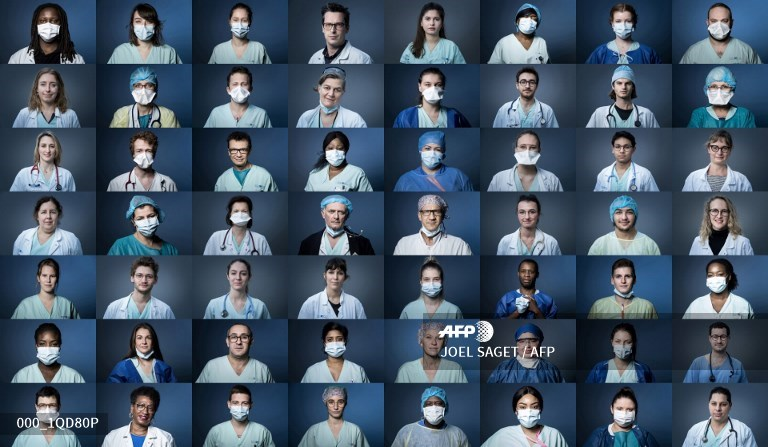 #Coronavirus #COVID19 #France Portraits of medical staffers on the frontline at the Georges Pompidou Hospital in Paris.  @JoelSaget #AFPpic.twitter.com/DzmPr5jYk0